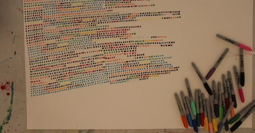 Image of writing and pens in lots of colours