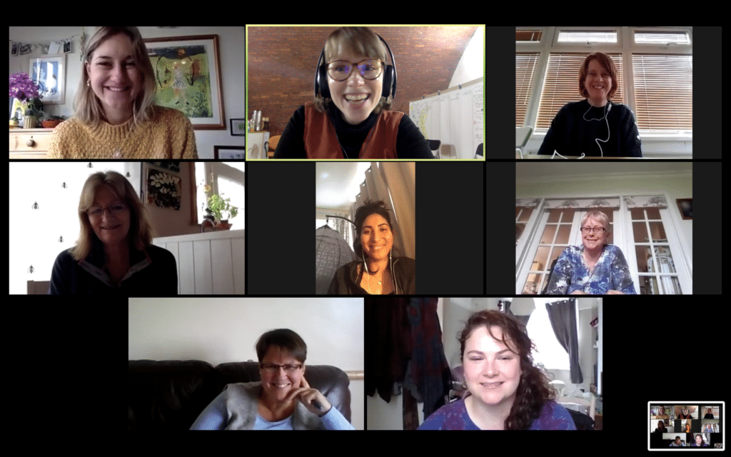 Photo of Zoom meeting of everyone who attended smiling